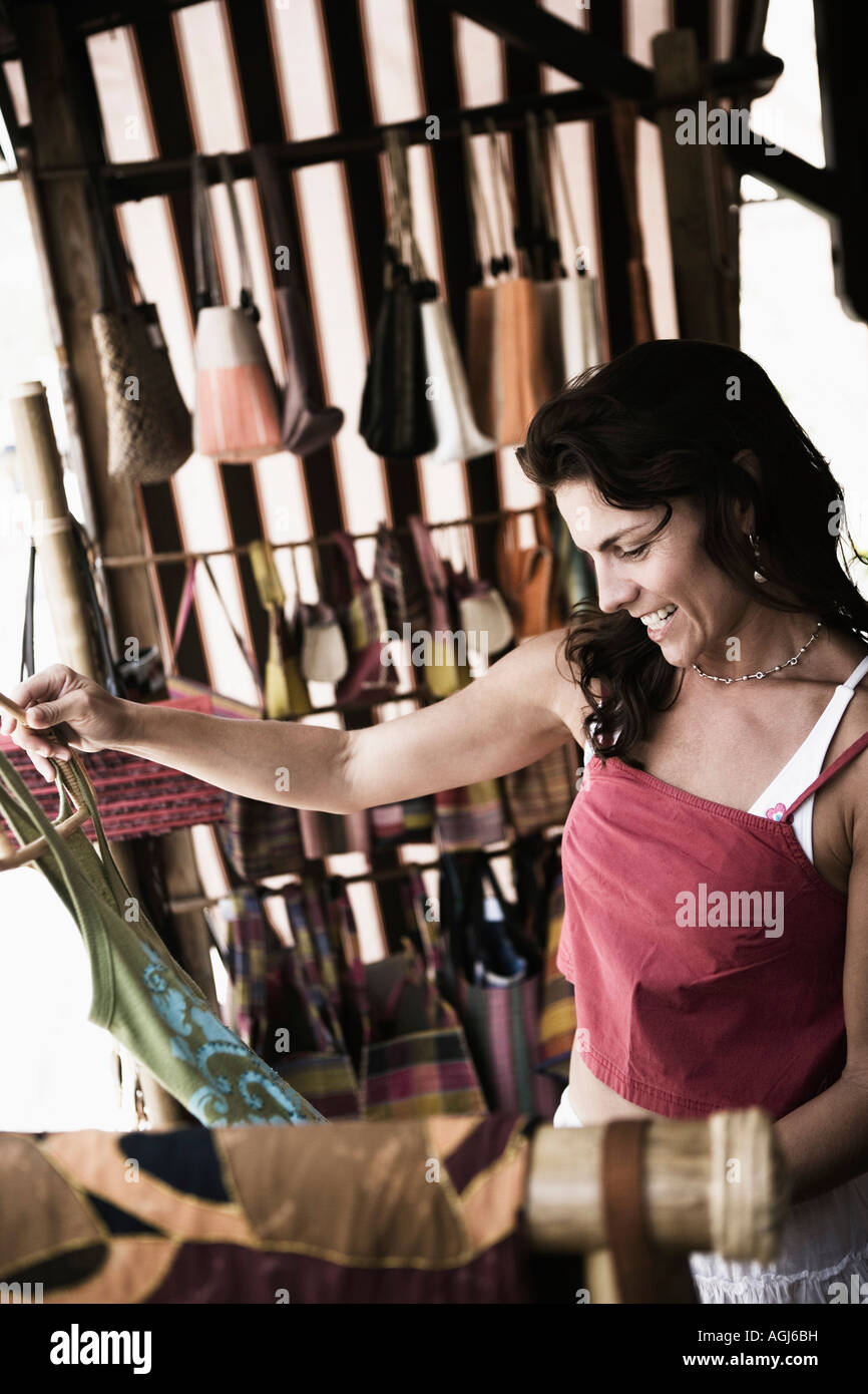 Mid adult smiling woman in clothing store (owner, shop, store