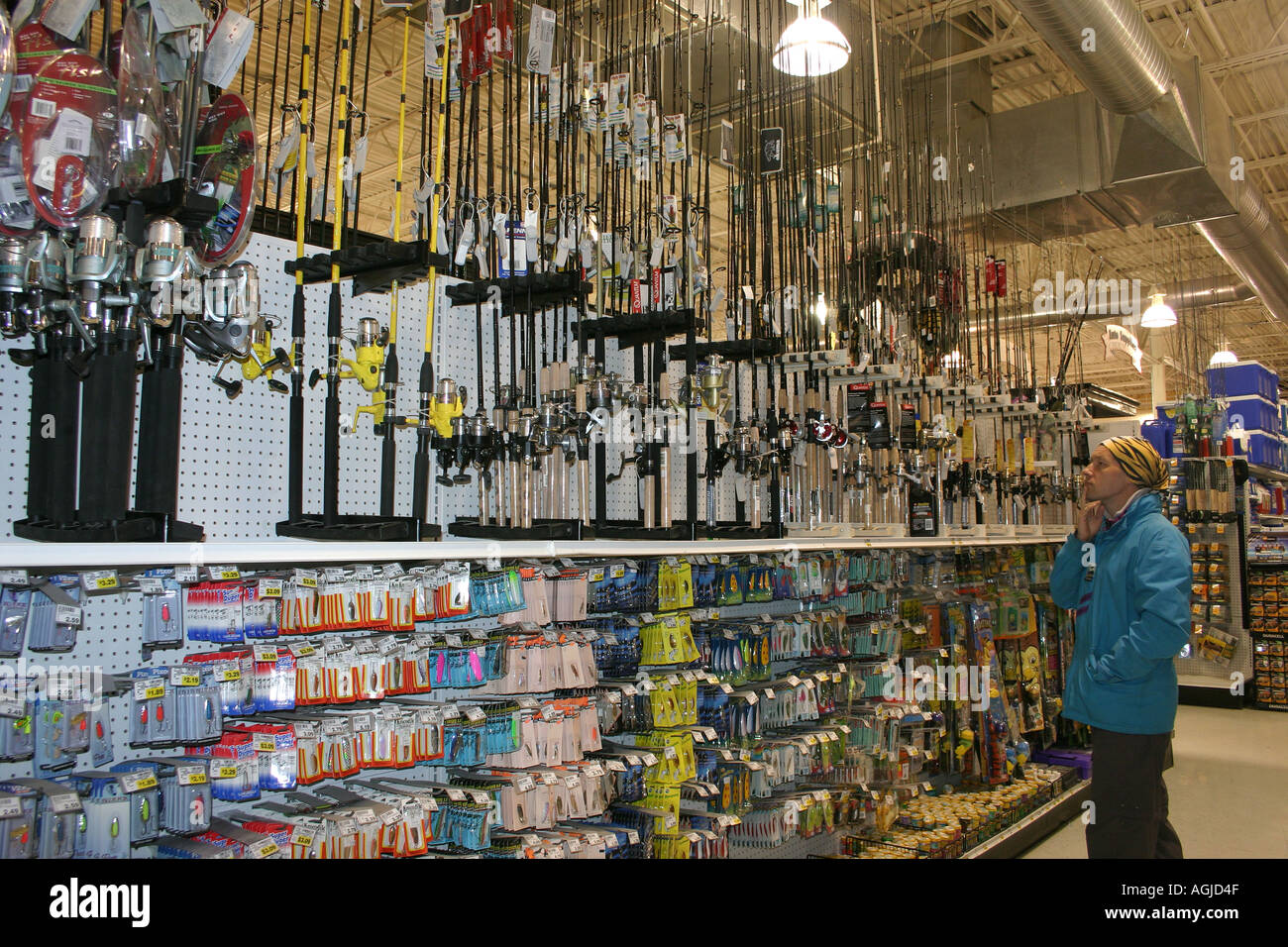 Mr man studies the fishing gear in a hardware shop in for Fishing gear store