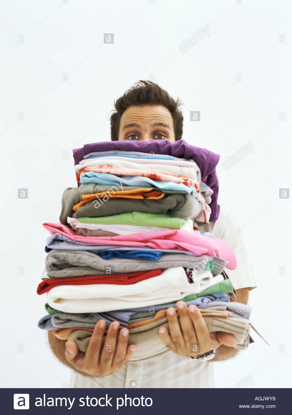 clothes shop assistant man stock photos clothes shop assistant man holding piles of clothes stock image