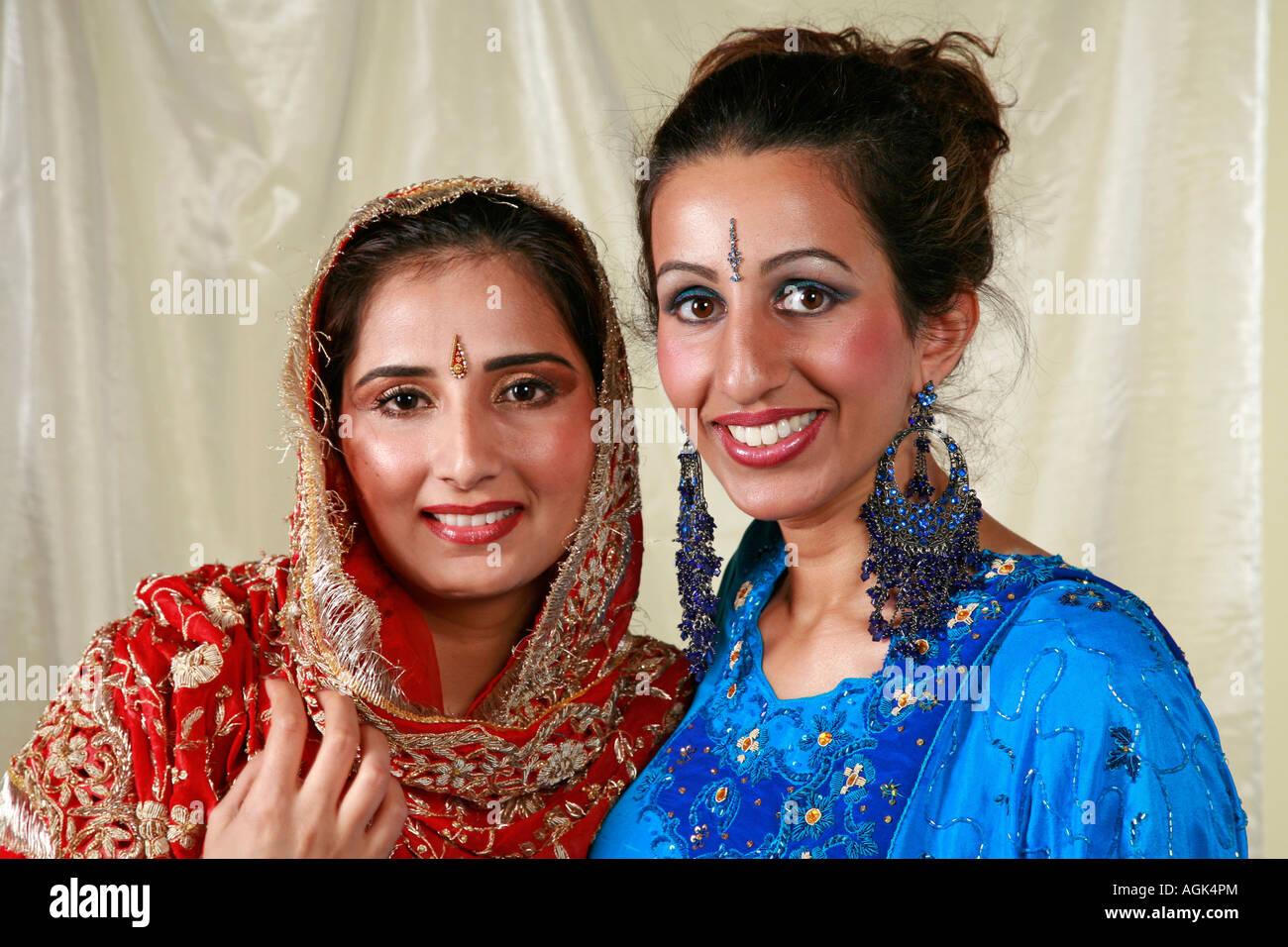 Asian Women In Traditional Indian Wedding Dresses With Jewellery Earrings Tikka And Bindi