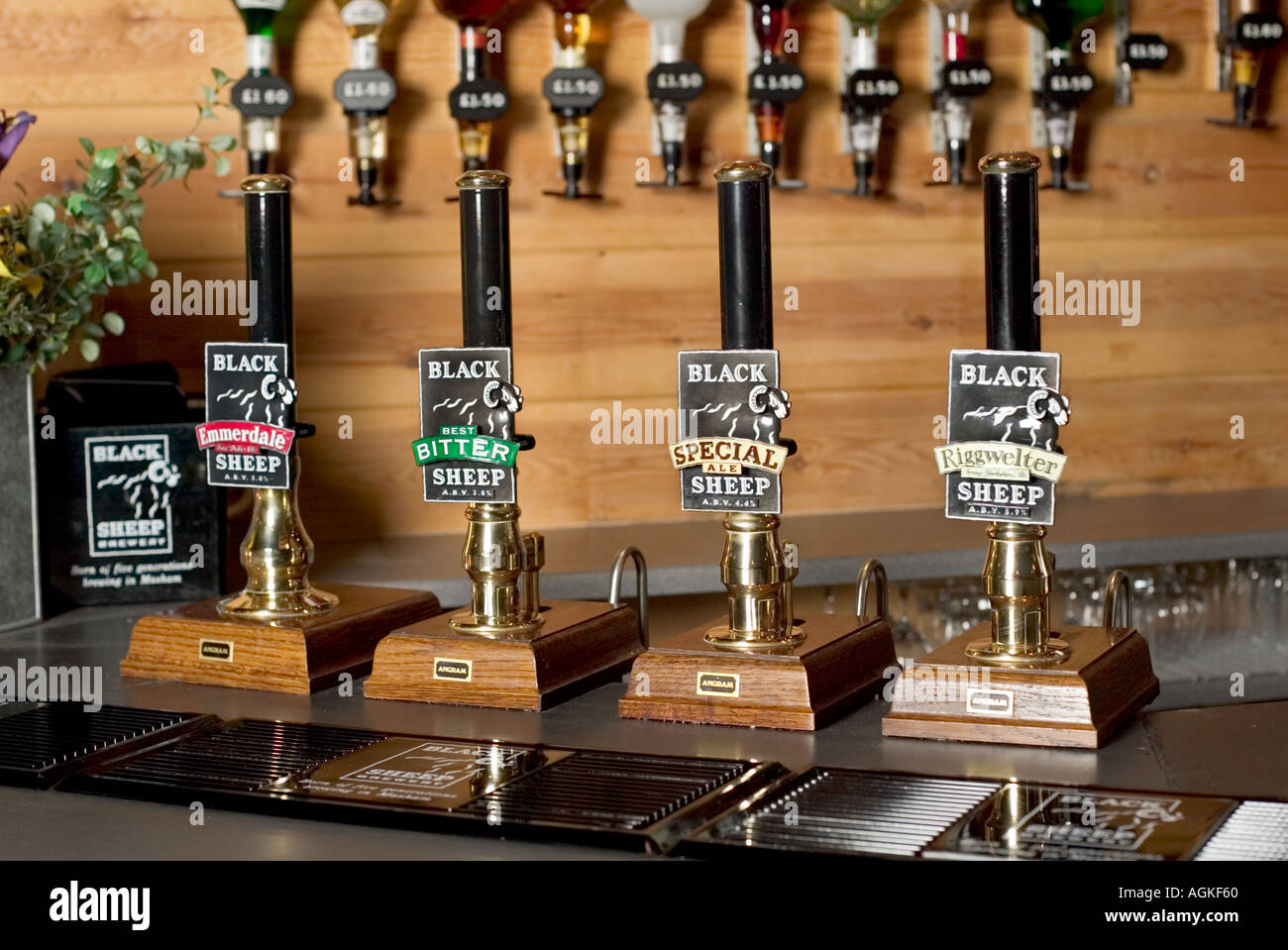 Beer Pumps On A Pub Bar Counter With Optics In Background