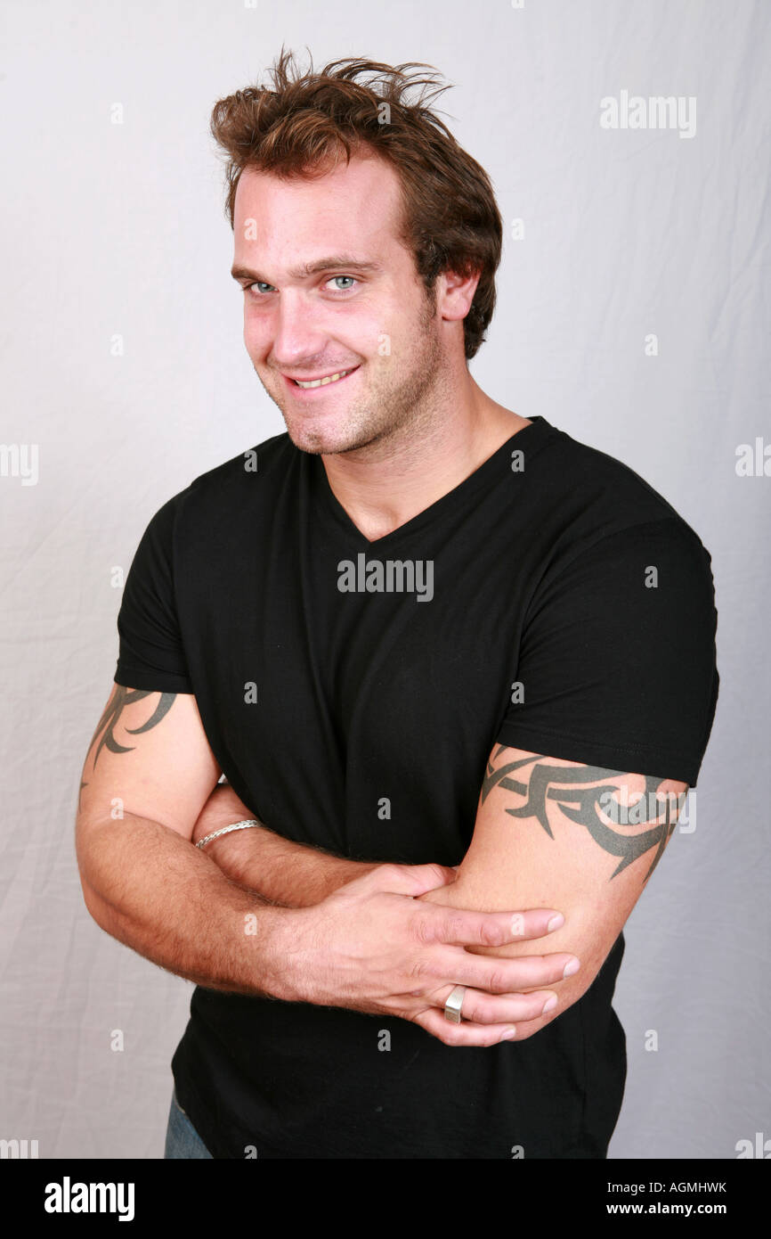 Well built muscular attractive 20's male man in black t shirt with ...