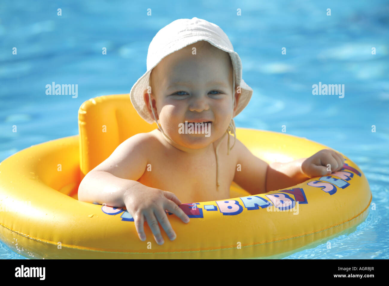 Baby Boy In Swimming Pool Summer Holiday Stock Photo