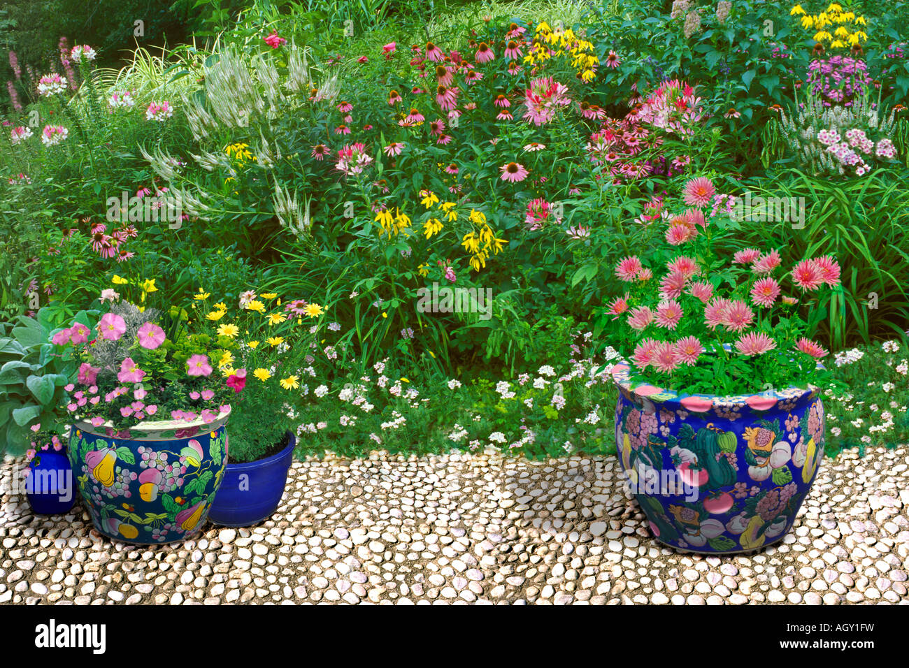 White cobblestone terrace with large oriental ceramic pots with white cobblestone terrace with large oriental ceramic pots with colors matching the wildflower garden of pink white and yellow workwithnaturefo