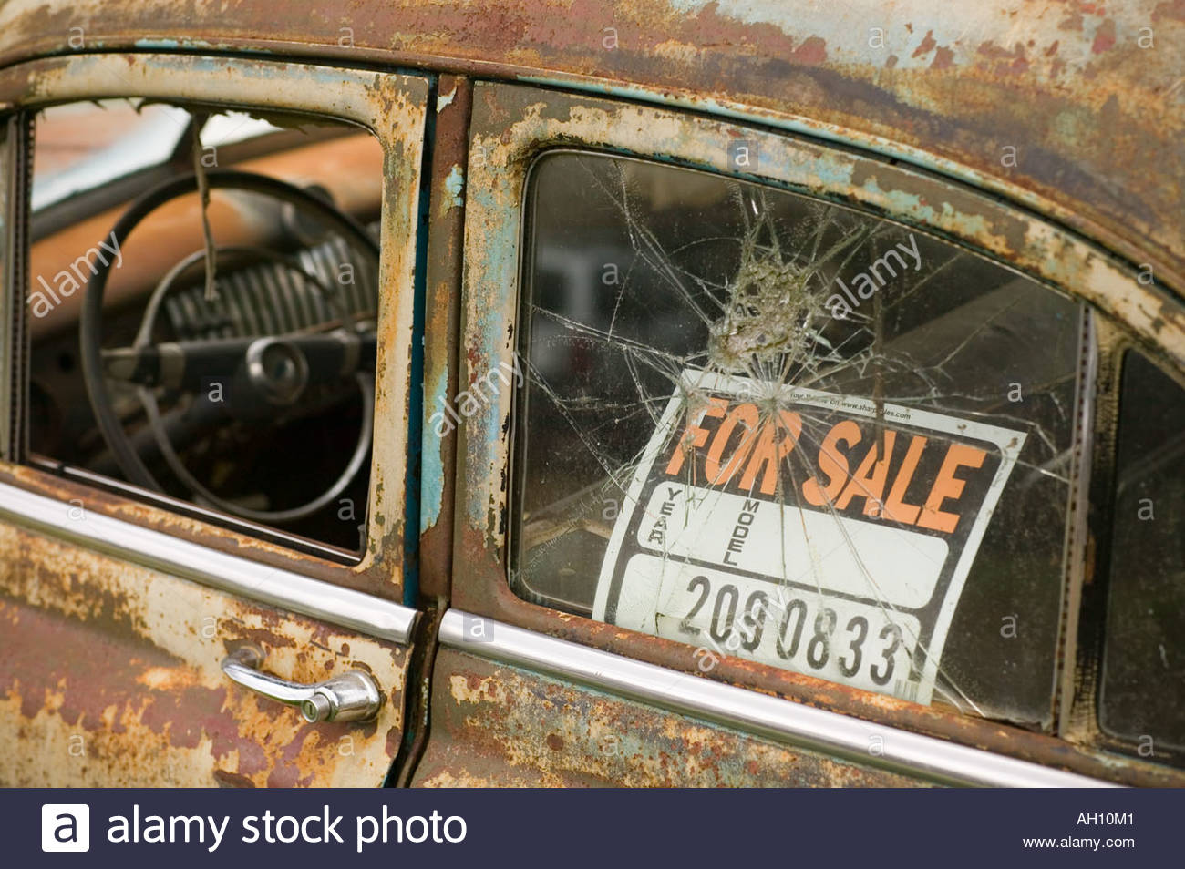 Old Rusted Car With For Sale Sign In The Window Sitting In A Field  Free For Sale Signs For Cars