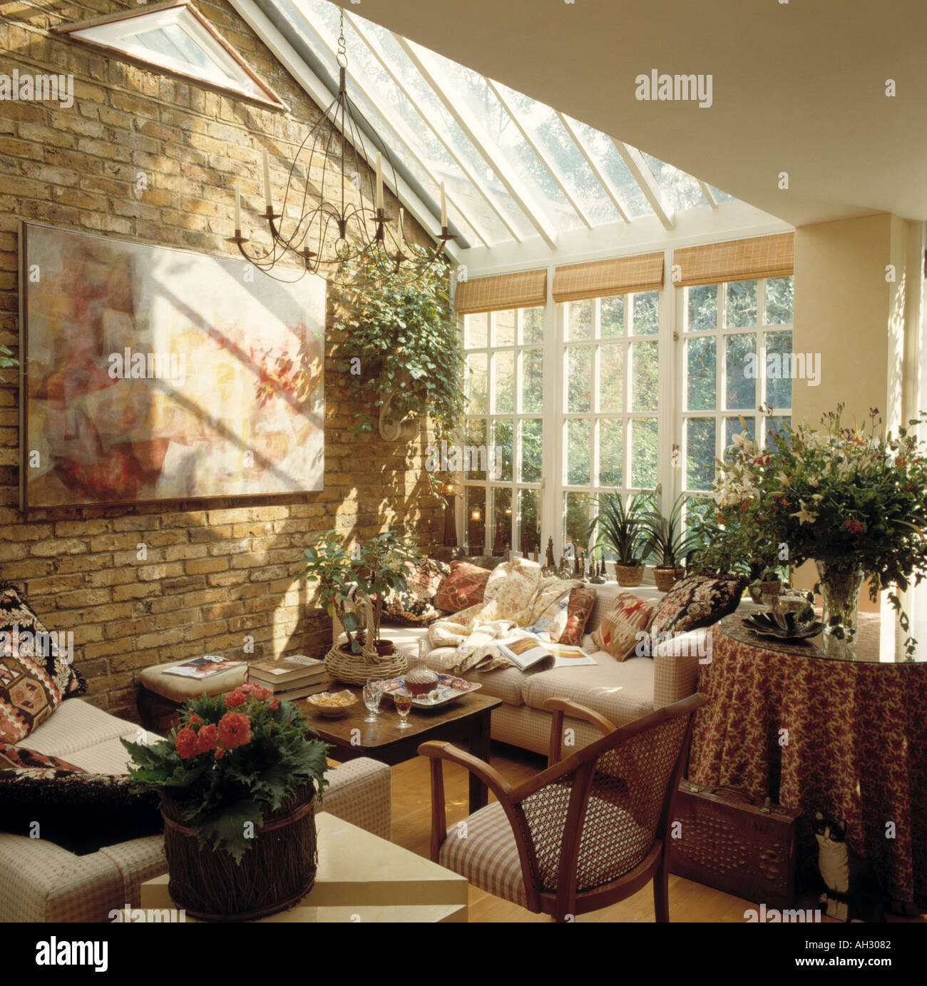 large picture on exposed brick wall in conservatory living room