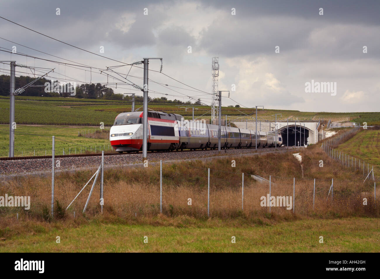 train on the paris to strasbourg tgv line emerging from tunnel stock photo royalty free image. Black Bedroom Furniture Sets. Home Design Ideas