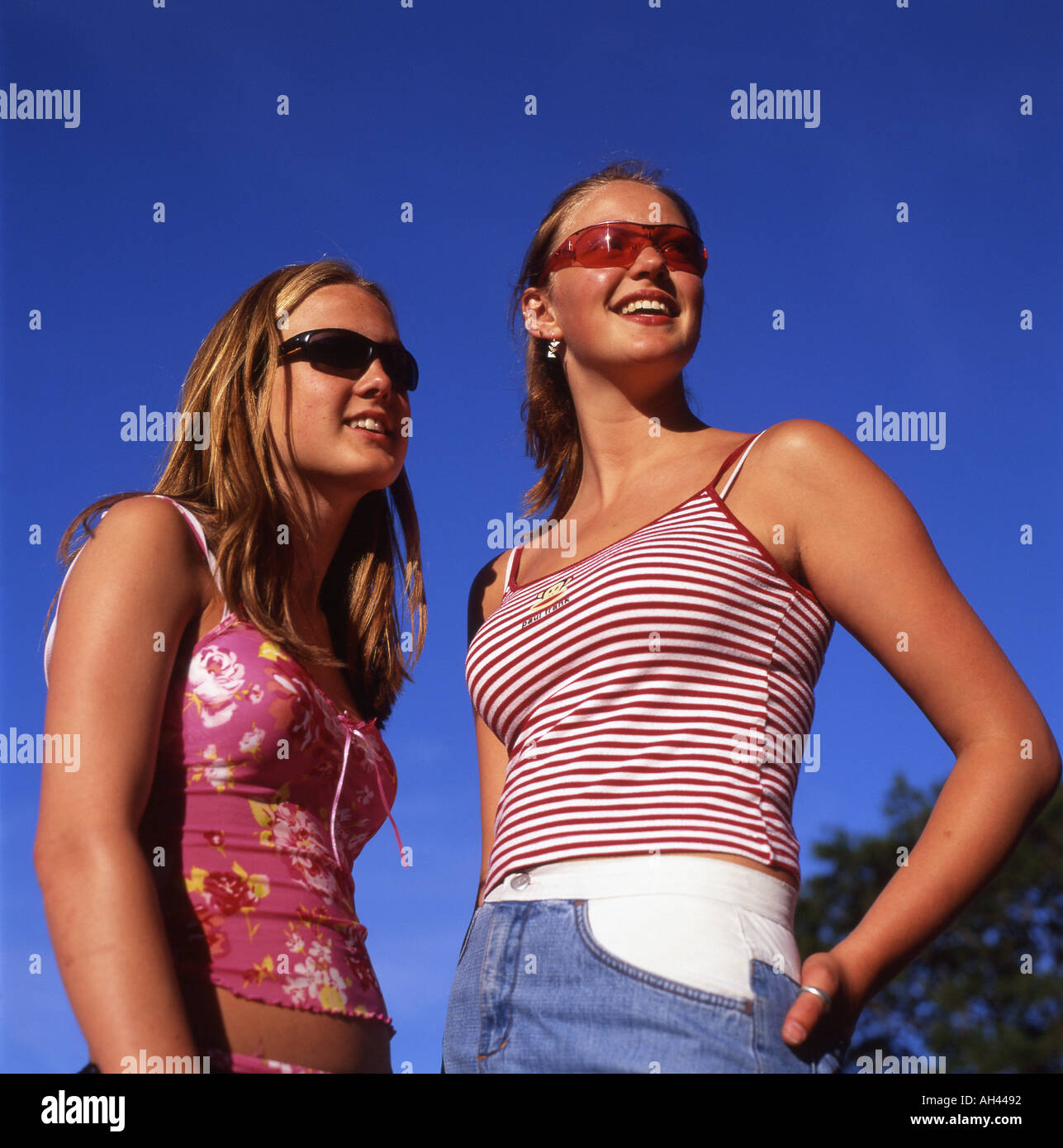 Small Teens two trendy teens teenage girls wearing sunglasses and small tops