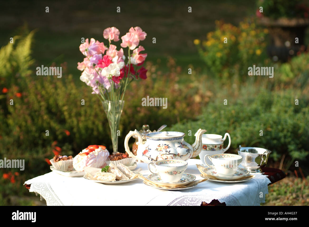 English country garden paintings - Stock Photo Afternoon Tea Set On The Lawn In English Country Garden