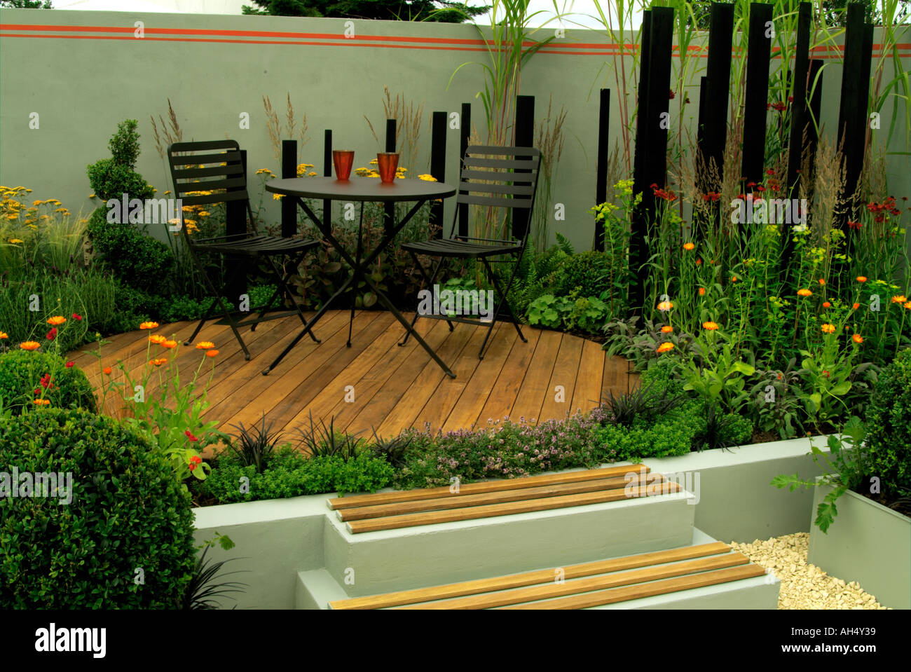 Garden Seating On Wooden Decking Overlooking Wildlife Pond