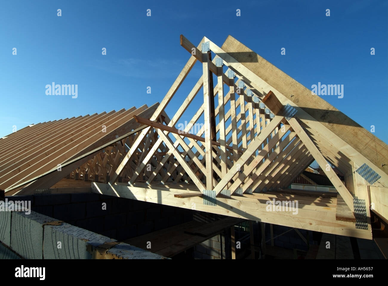 Essex house building site work in progress fixing for Prefabricated roof truss