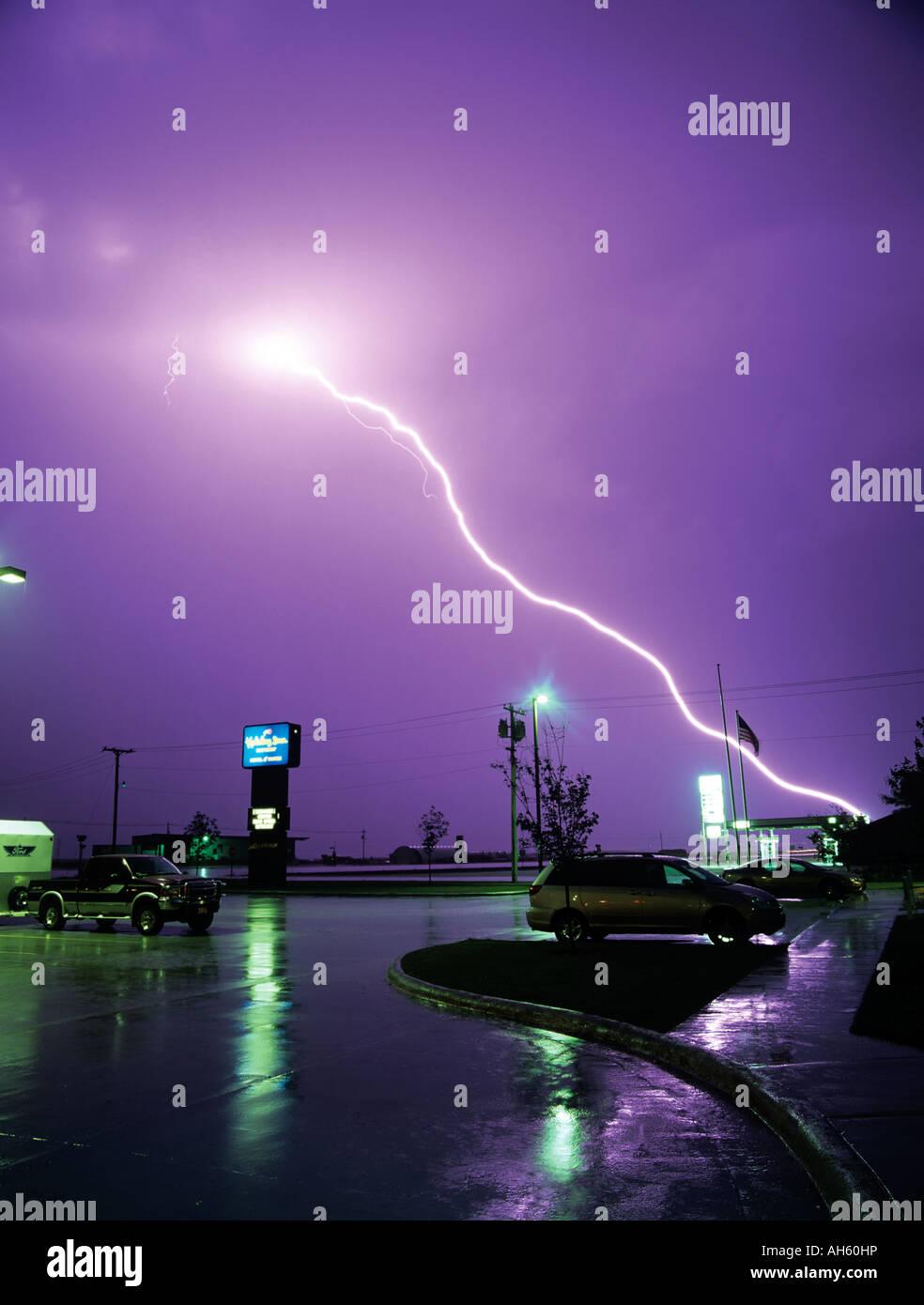 lightning strikes over a wet car park and motel sign in valentine nebraska - Motels In Valentine Nebraska