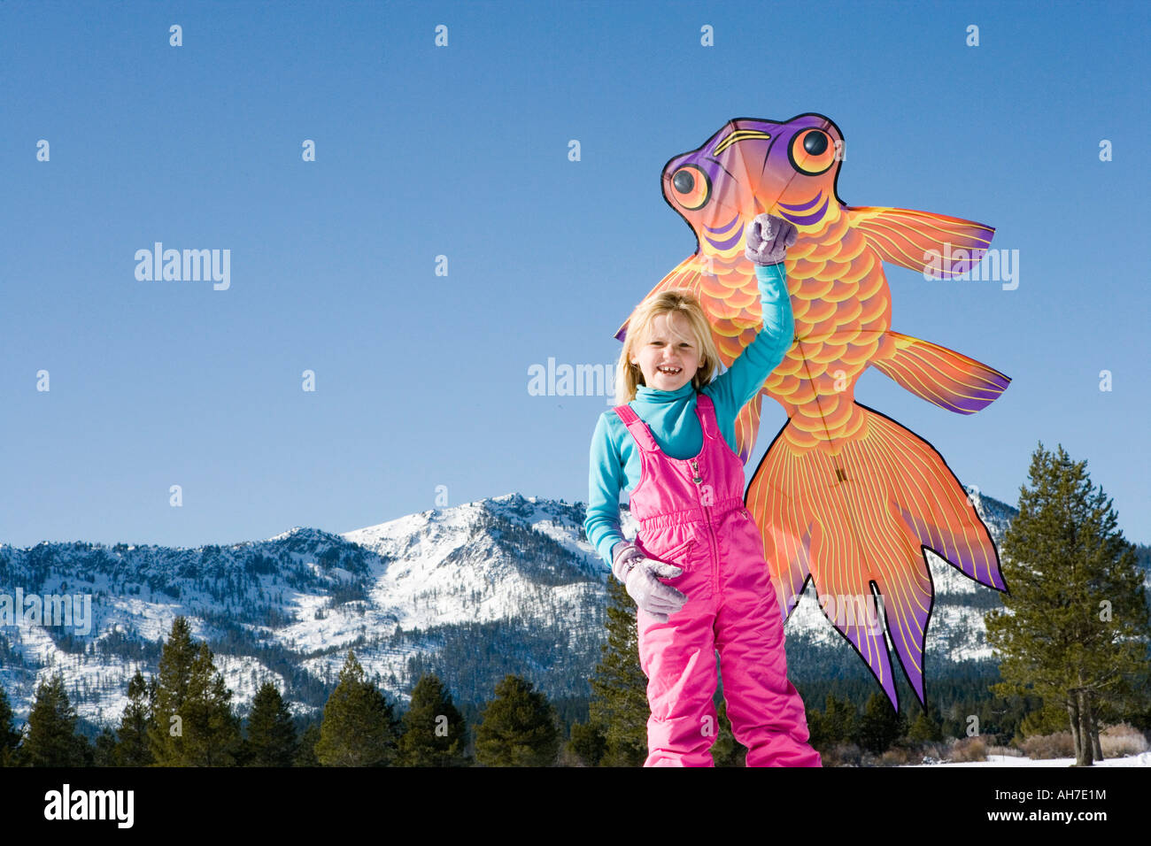 Low Angle View Of A Girl Holding A Kite Stock Photo