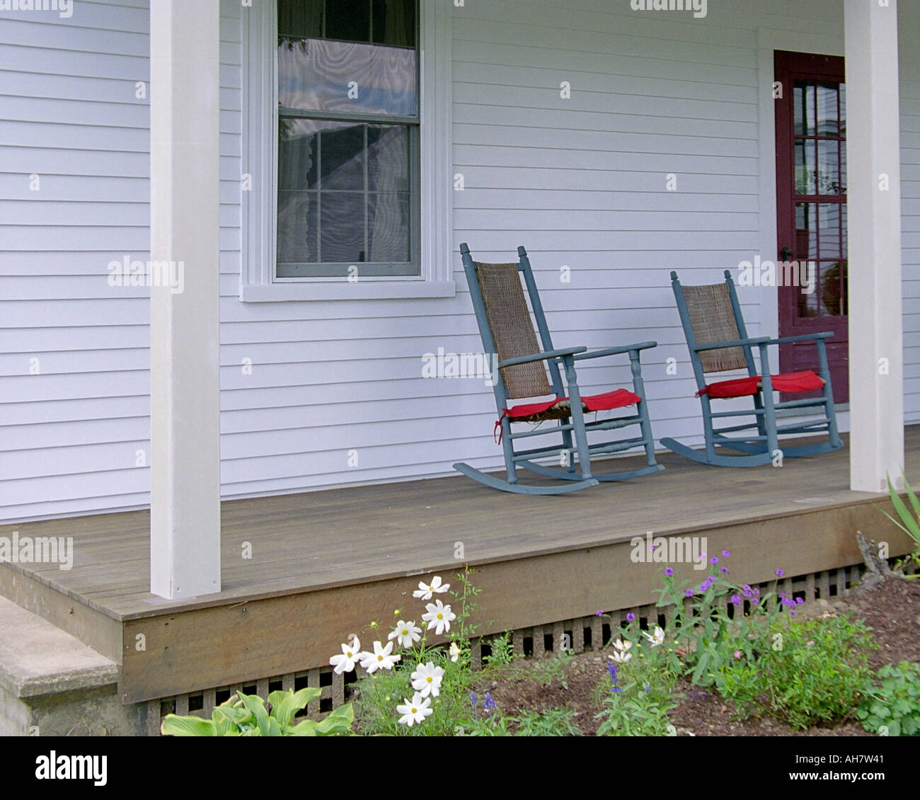 Front Porch Of Yellow House Stock Photo: The Front Porch Of A Rural New England Farmhouse Stock