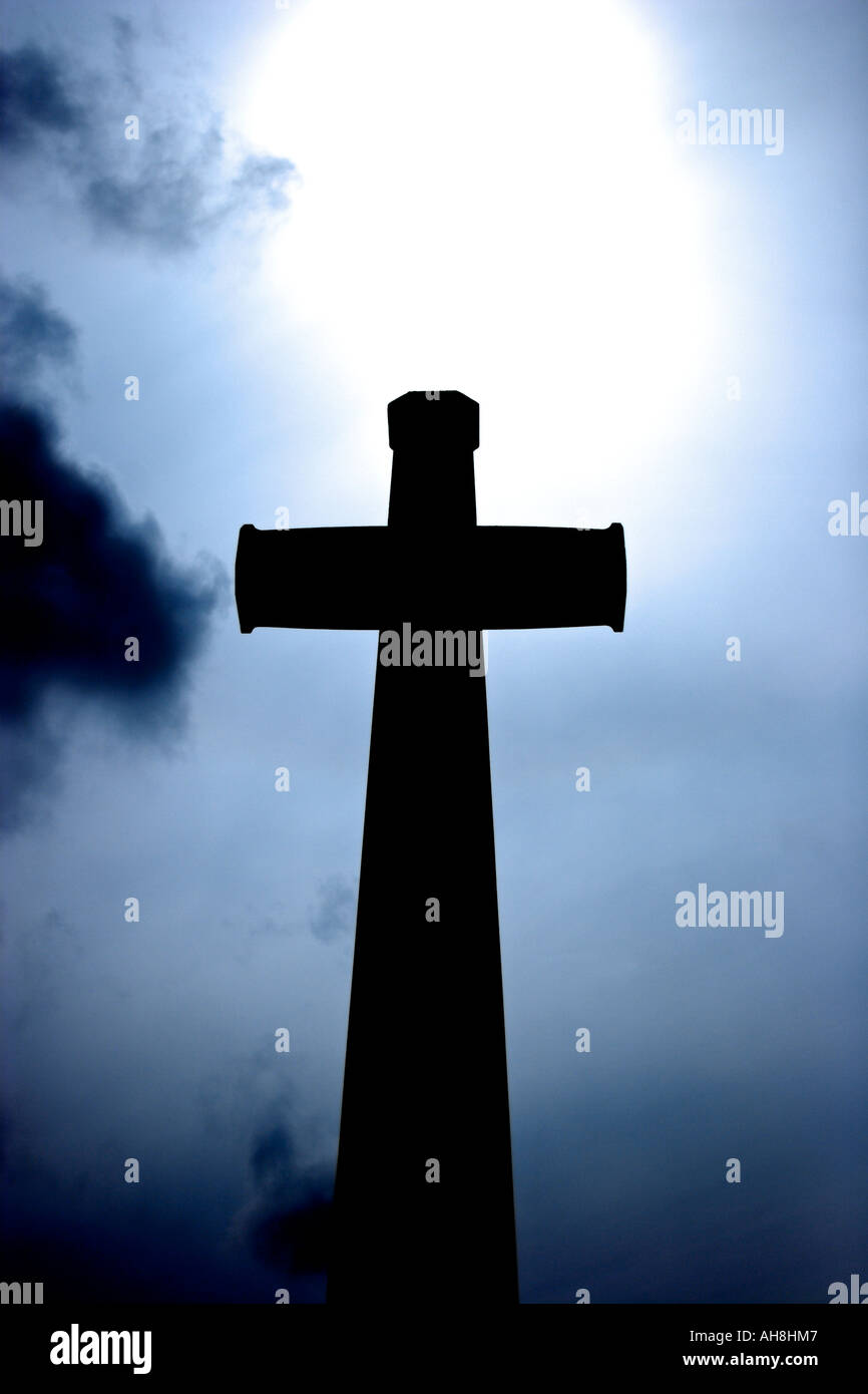 Silhouette of the holy cross on background of storm clouds stock - Silhouette Of A Holy Cross With Dramatic Blue Sky