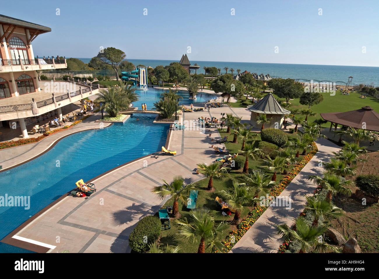 Mediterranean Sea With Gardens And Swimming Pool Of Papillon Zeugma 5 Stock Photo Royalty Free