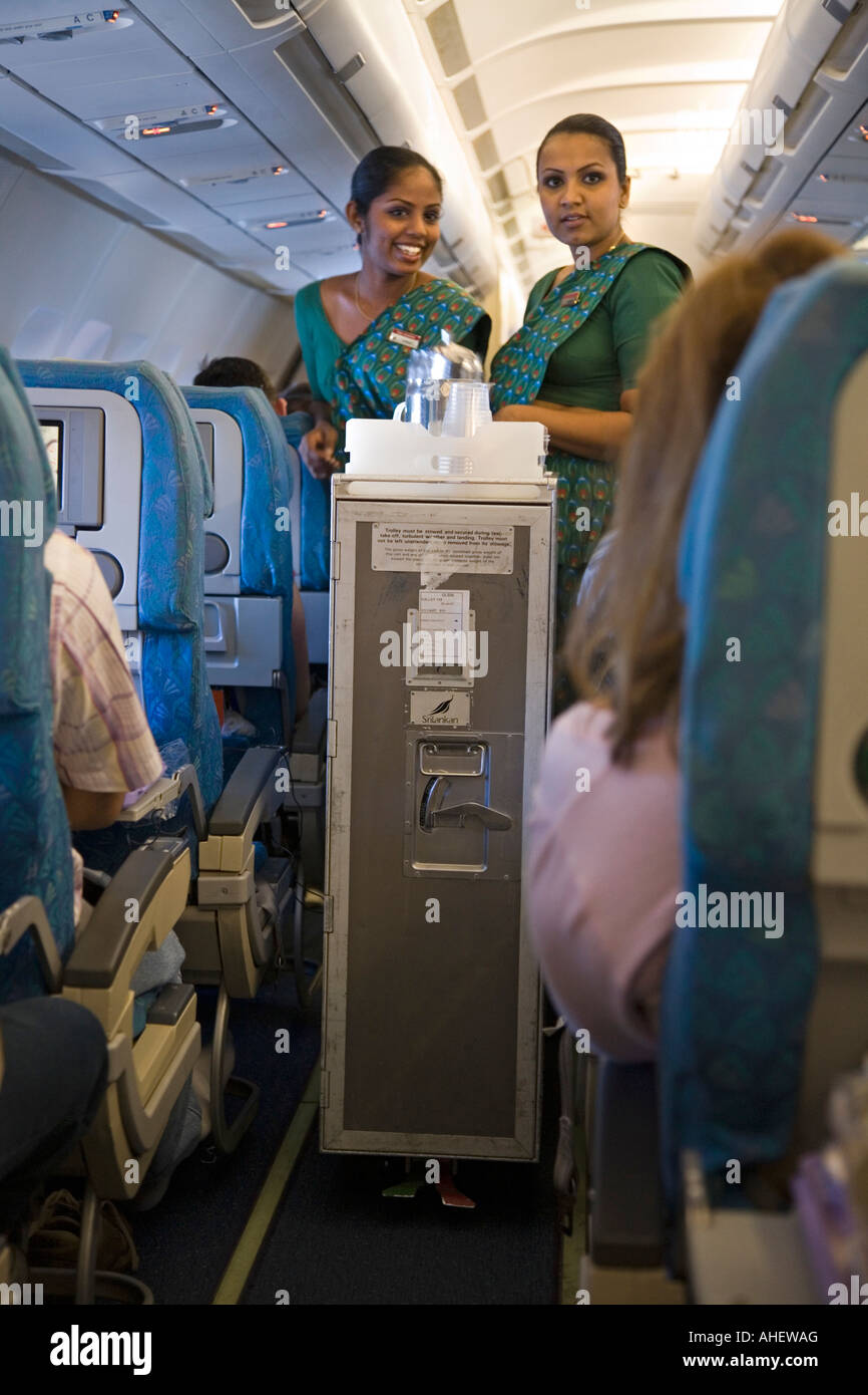 Cabin Crew With A Food And Drinks Trolley On A Srilankan