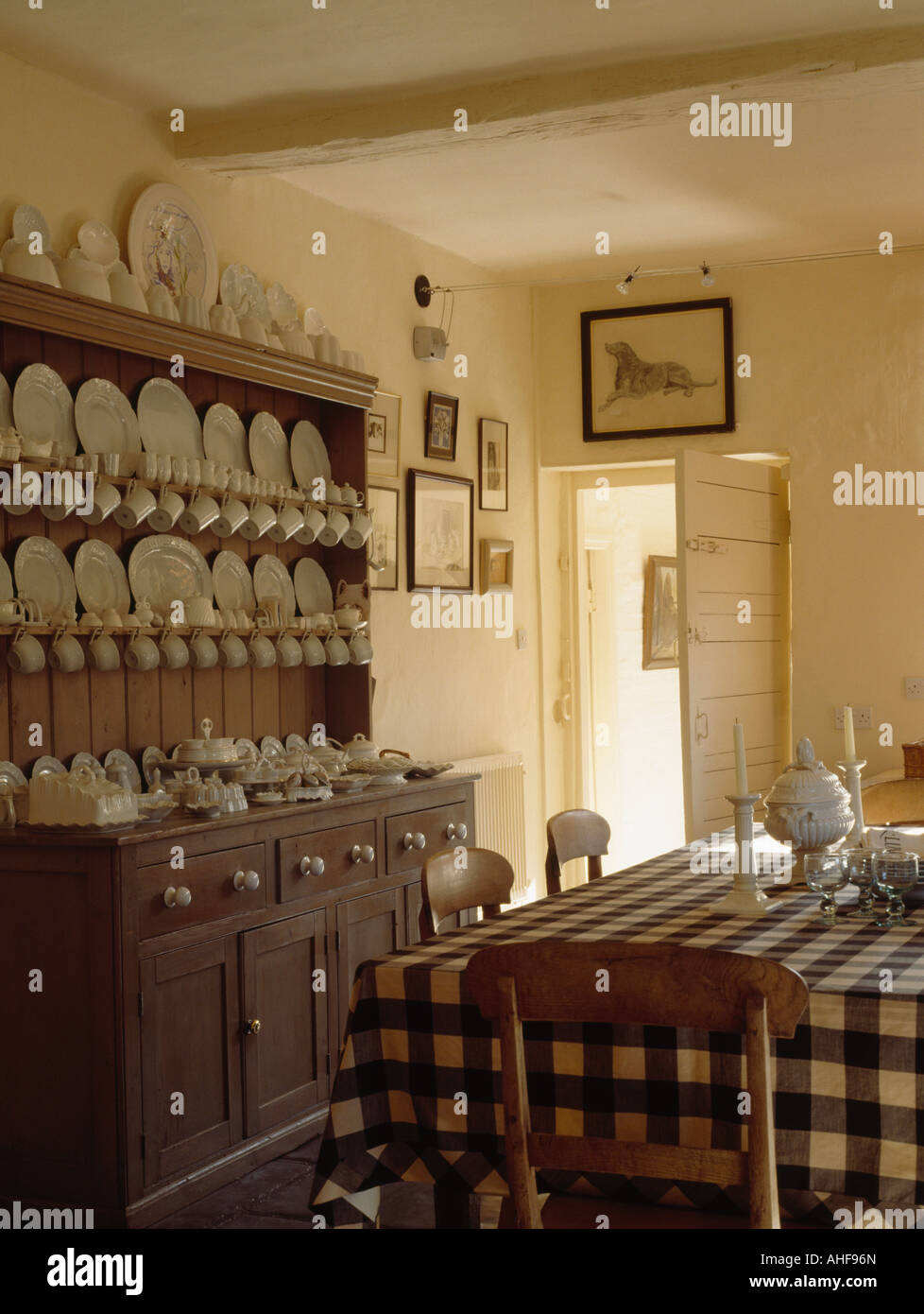 White Crockery On Antique Pine Dresser In Country Dining Room With Blue Checked Cloth Table