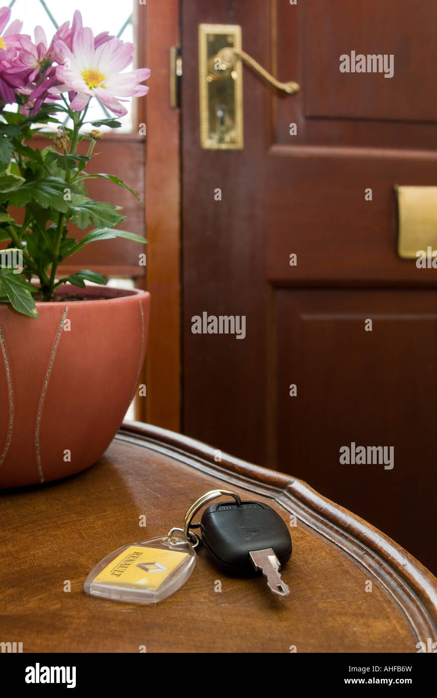 front door tableCar key left on a table by the front door Stock Photo Royalty