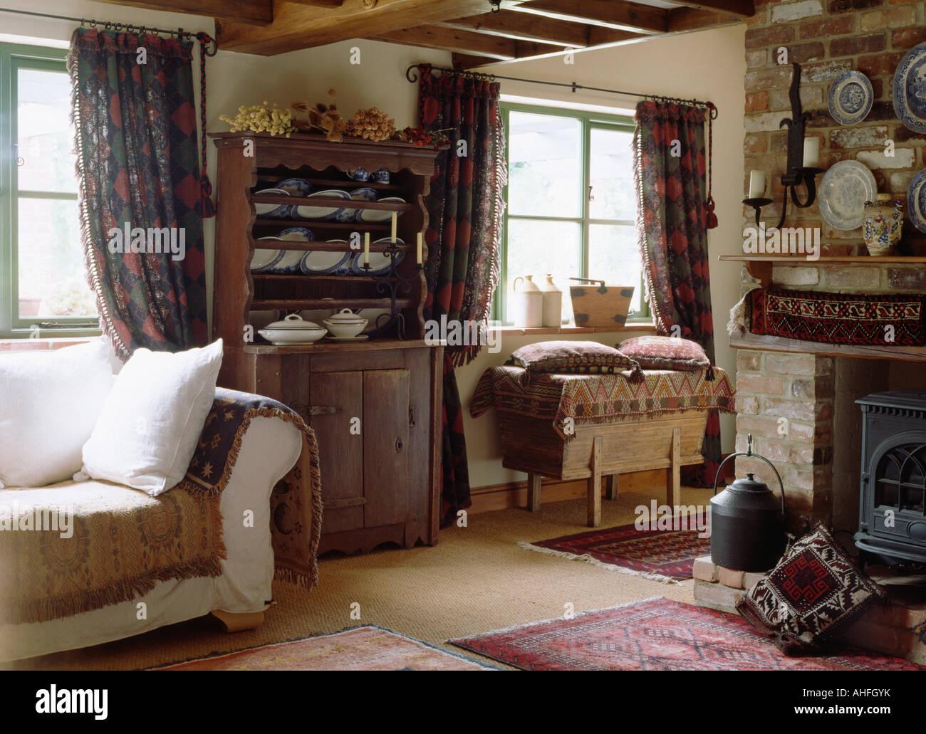 Antique Pine Dresser Beside Cream Sofa In Cottage Living Room
