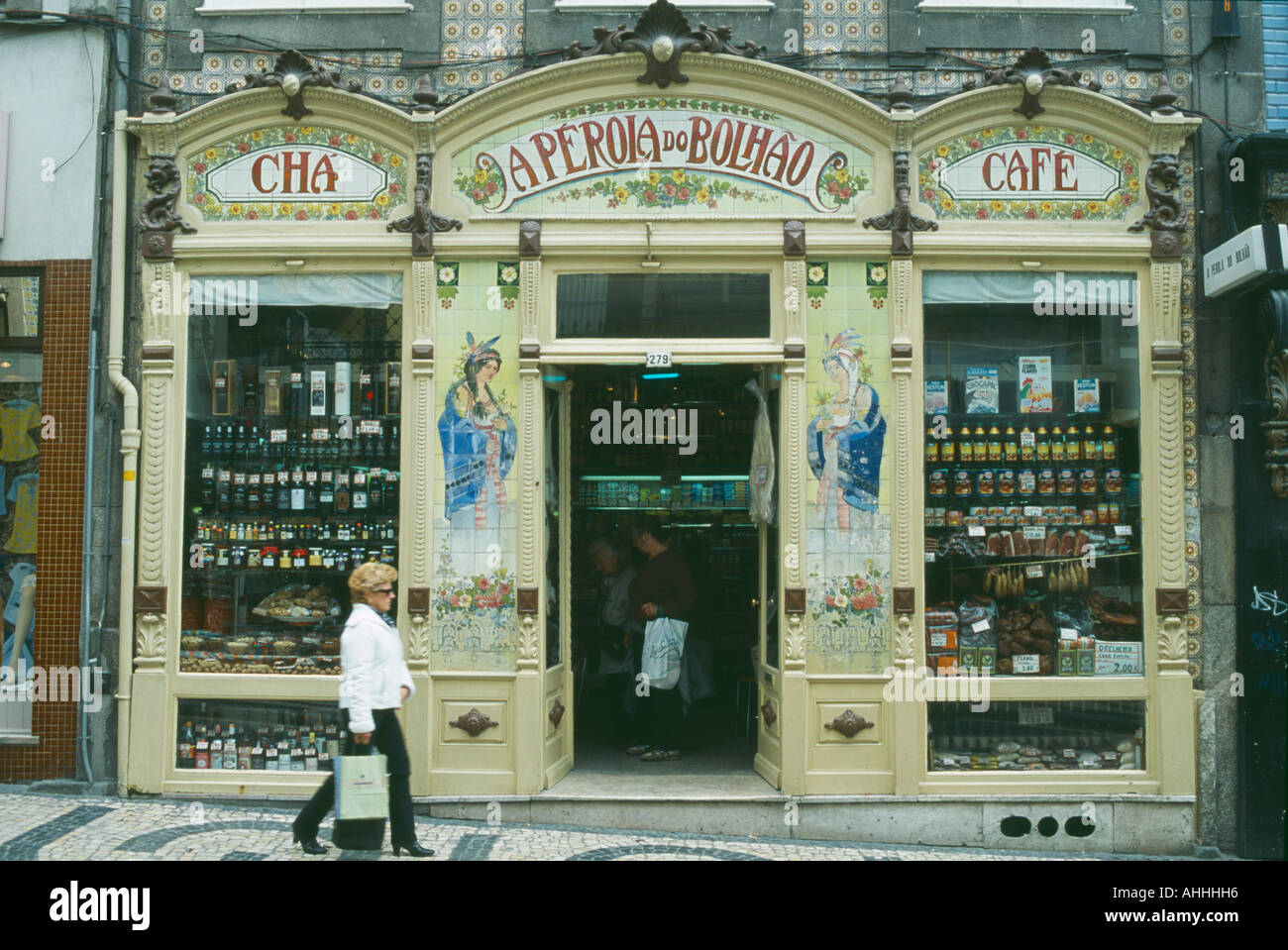 PORTUGAL Porto Oporto Shop front with mosaic tiles and display of ...