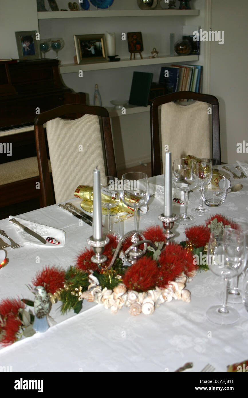 Dining room table set for christmas dinner with pohutukawa for Dinner table flower arrangements