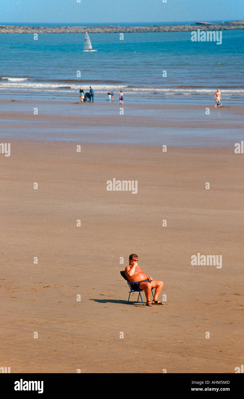 a-man-sitting-in-a-deck-chair-on-a-compl