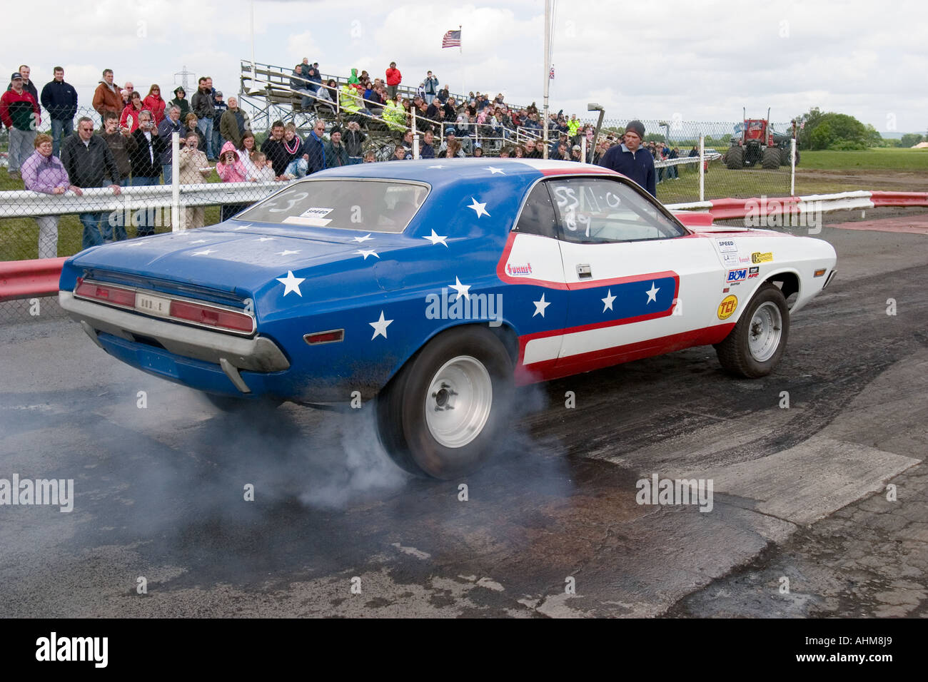 American Muscle Car Doing A Burnout At Drag Race Stock Photo