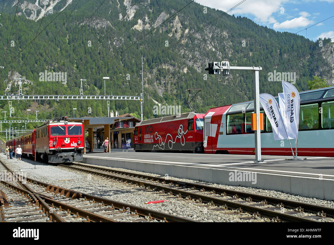 st moritz bound glacier express train meets chur bound rhatische stock photo royalty free. Black Bedroom Furniture Sets. Home Design Ideas