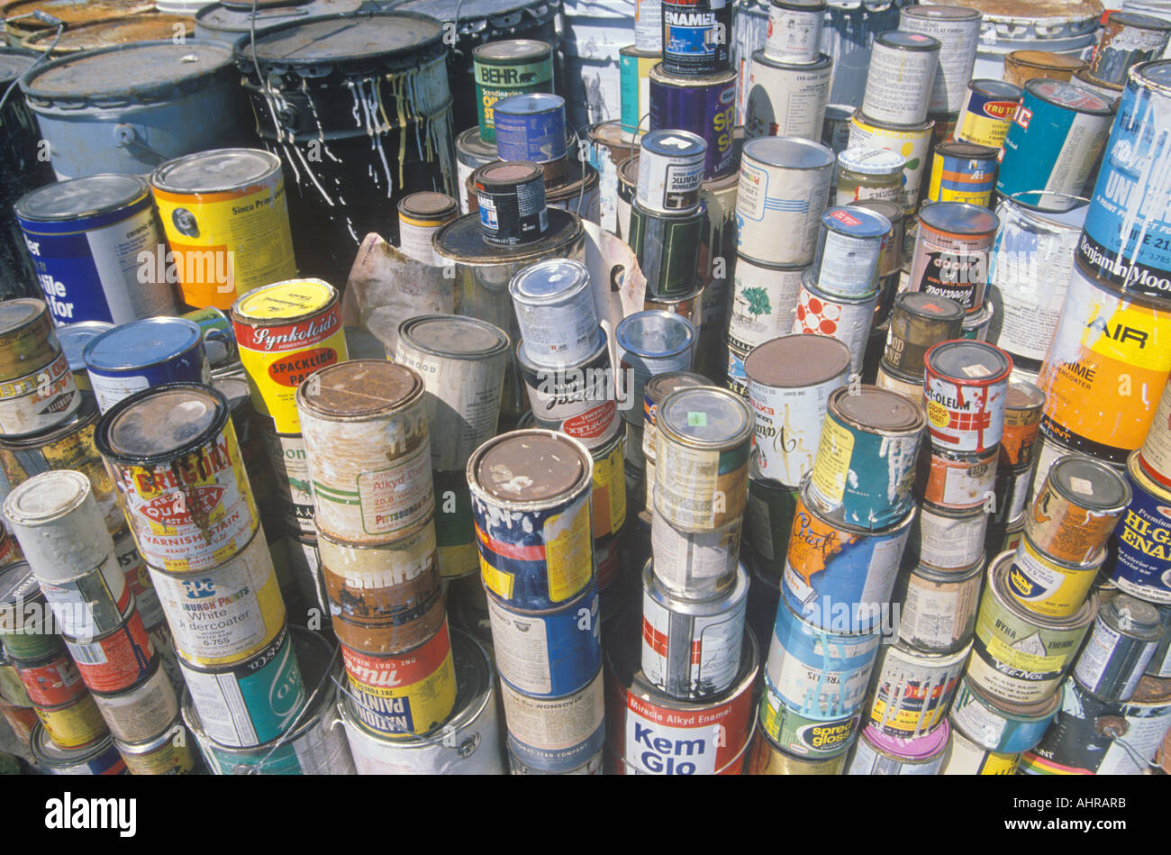 Stacks of toxic paint cans waiting for disposal at a for How to dispose of empty paint cans