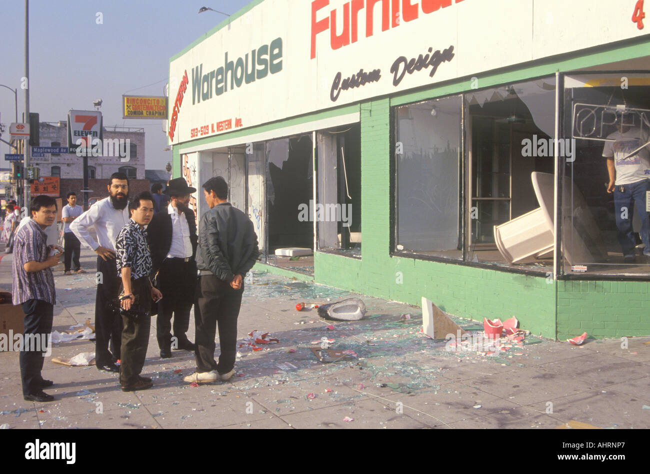 Ethnic Men Observing Furniture Store Looted During 1992 Riots South Central  Los Angeles California