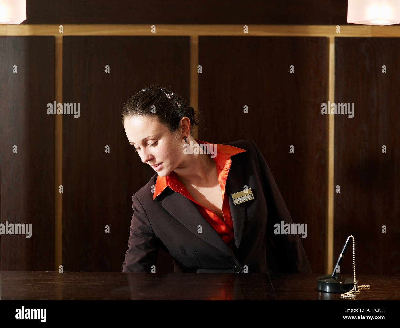 Young female hotel receptionist Stock Photo, Royalty Free ...