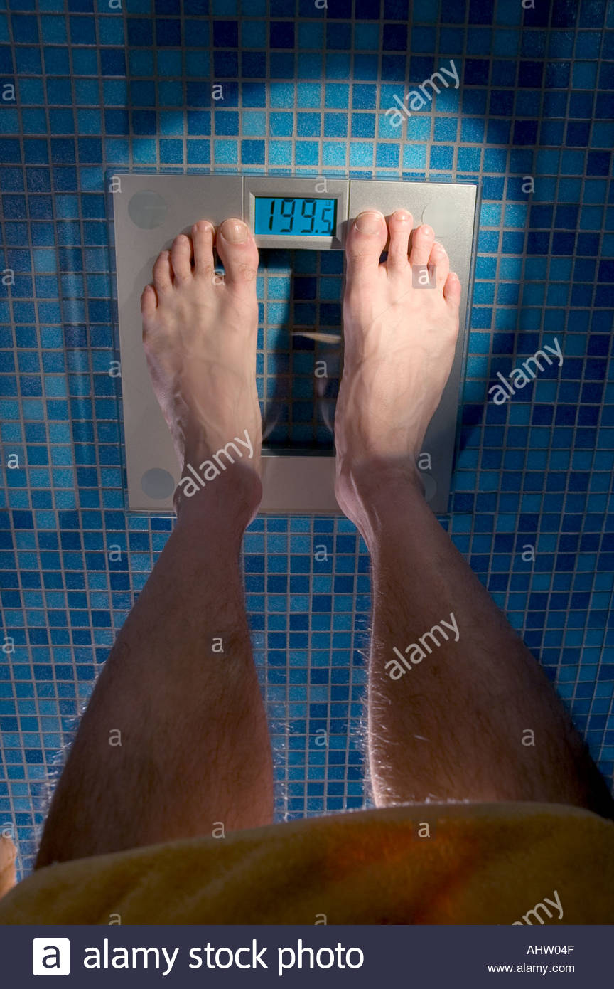 Point Of View Mans Feet Scale Blue Glass Tile Floor In Bathroom Looking  Down At Weight Did I Gain Or Loose? 199 5 Pounds