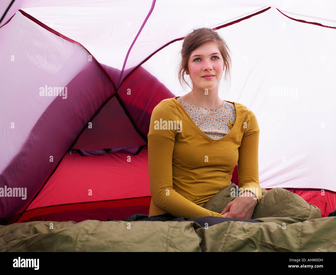 Girl sitting in sleeping bag in pink tent  sc 1 st  Alamy & Girl sitting in sleeping bag in pink tent Stock Photo: 14548060 ...