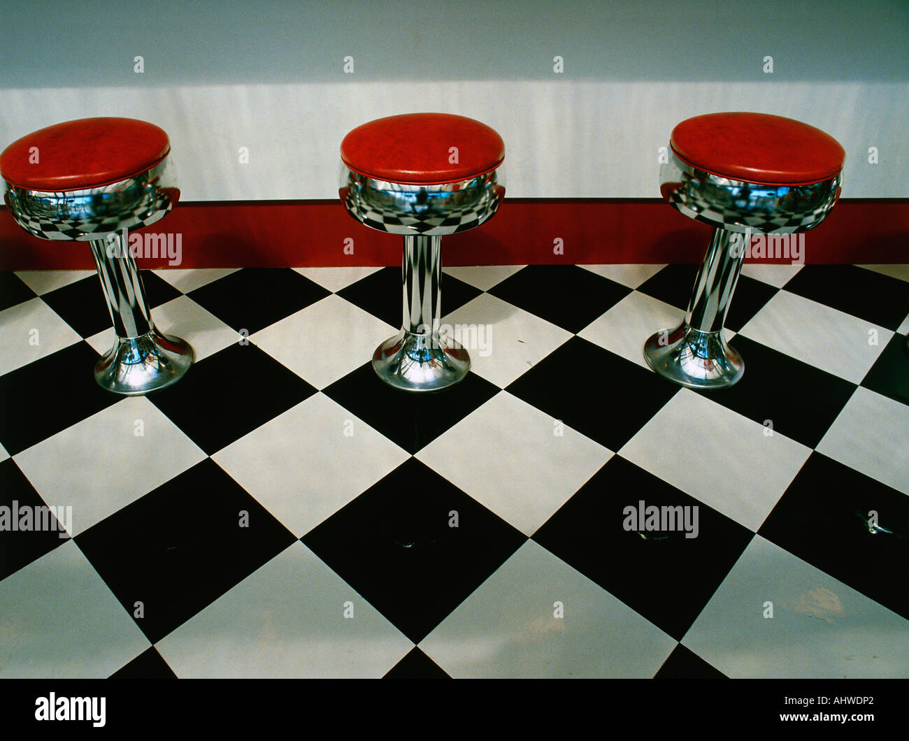 This is an art deco style restaurant it has a black and white this is an art deco style restaurant it has a black and white checkerboard tile floor with red vinyl stools next to the counter dailygadgetfo Gallery
