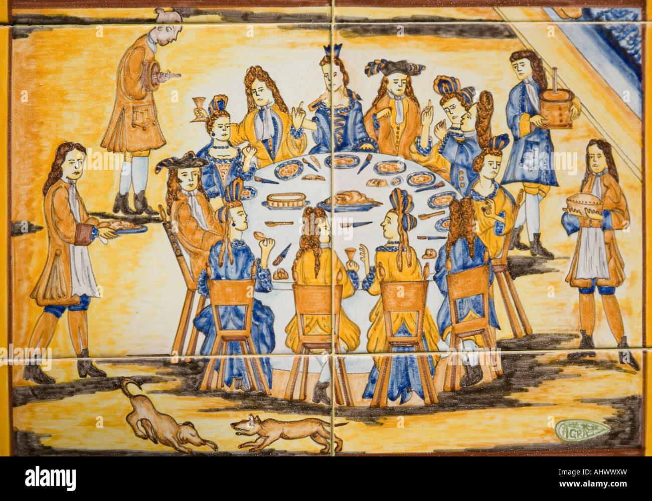 Ceramic tiles representing medieval dinner scene advertising the ceramic tiles representing medieval dinner scene advertising the asociacion de restaurantes gastronomicos de andalucia dailygadgetfo Choice Image