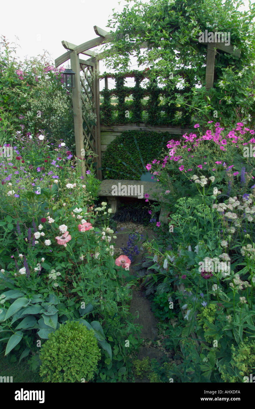 Old Tarnwell Somerset UK Des Mary Payne Small Back Garden Well Packed With  Plants With Wooden