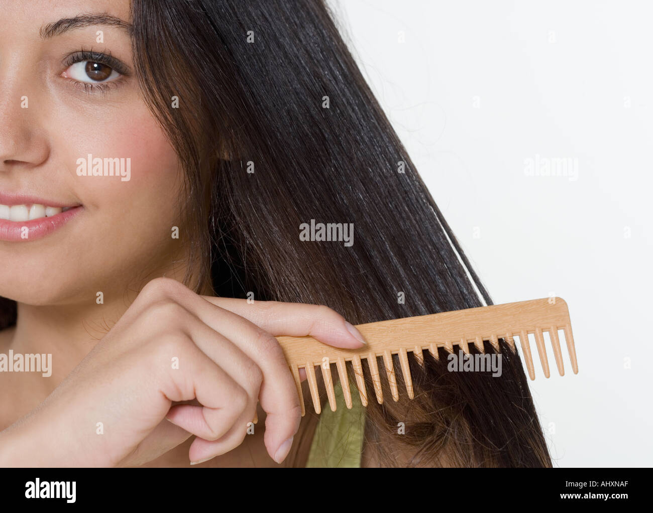 Woman combing hair with wooden comb stock photo royalty free stock photo woman combing hair with wooden comb urmus Choice Image