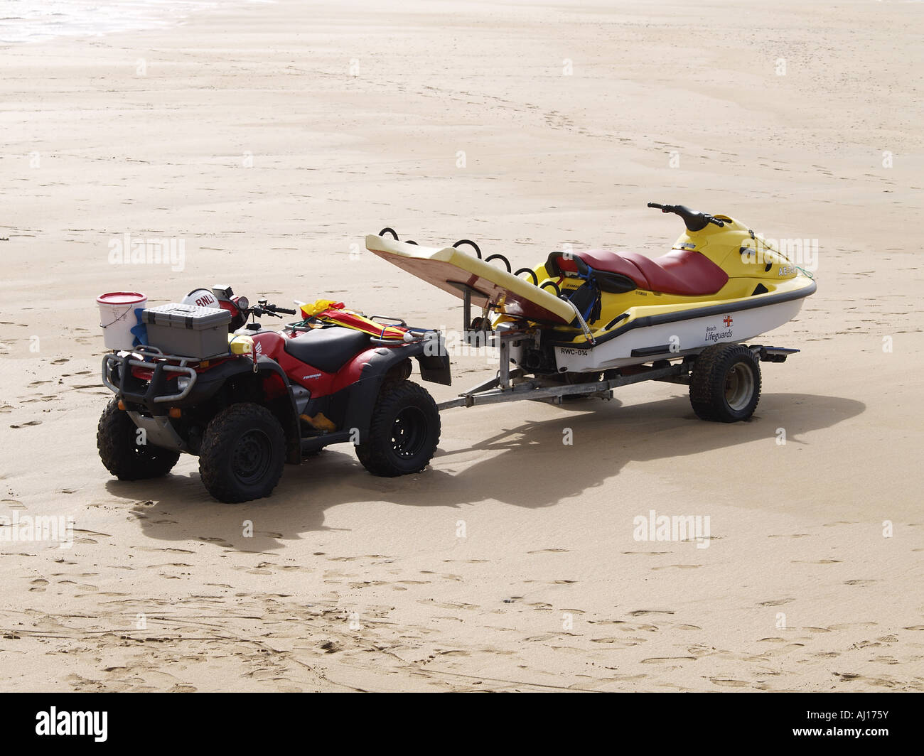 lifeguards jet ski on trailer attached to a quad bike stock photo royalty free image 14587958. Black Bedroom Furniture Sets. Home Design Ideas