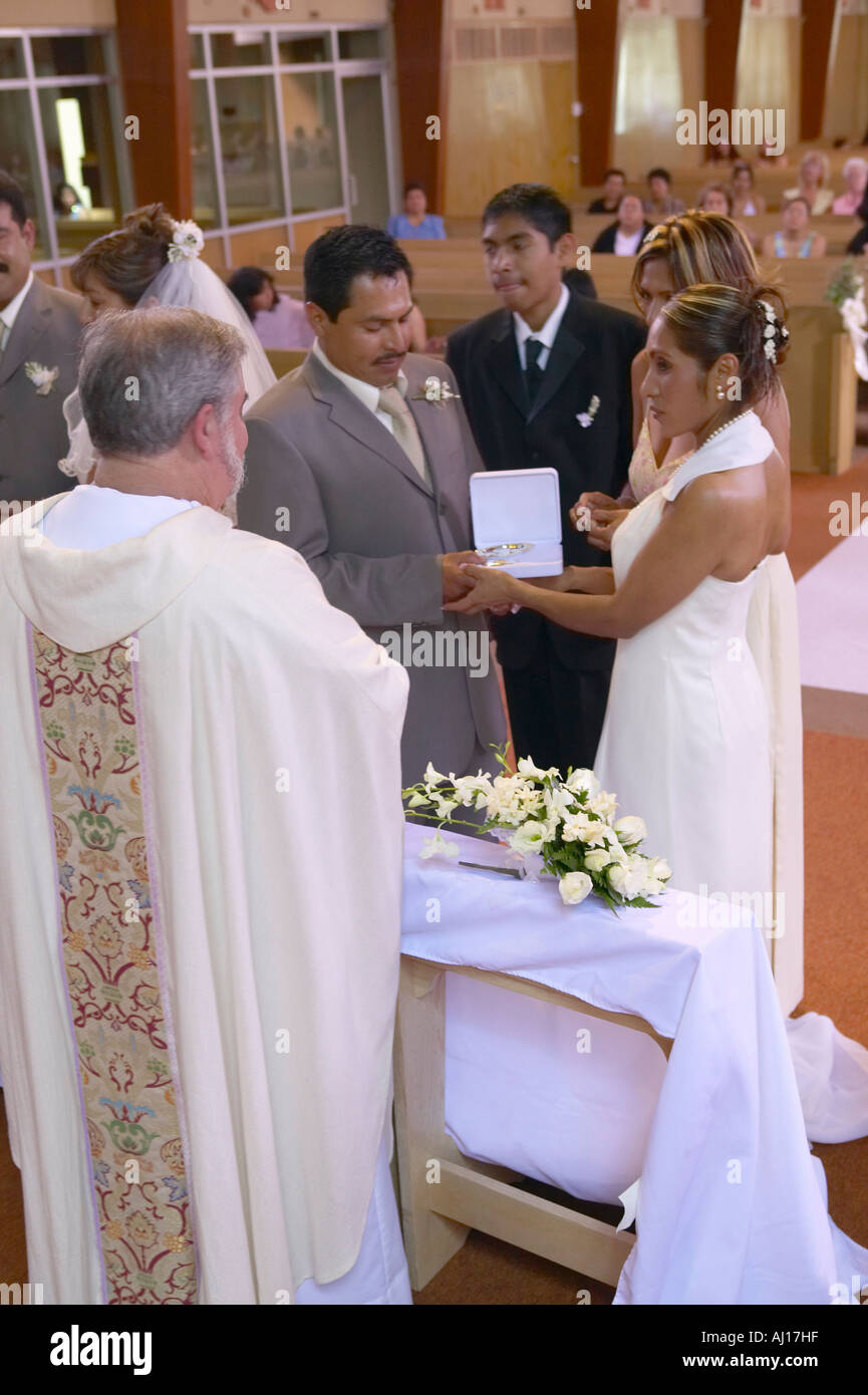 Catholic Priest Administers Wedding Vows To Latino American At St Thomas Church In Ojai California