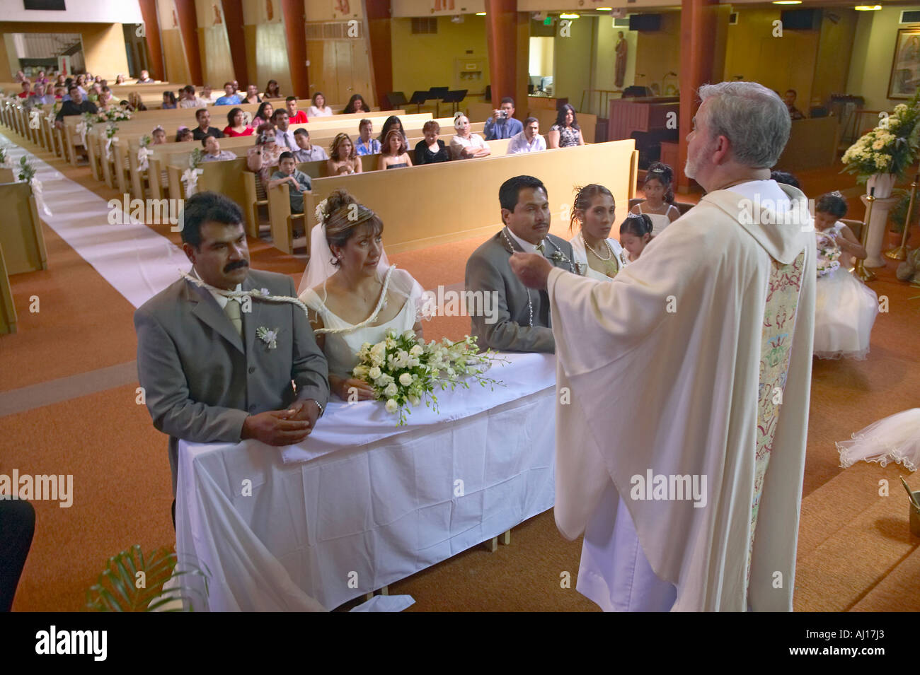 Catholic Priest Administers Wedding Vows To Two Latino American Couples At St Thomas Church In Ojai California