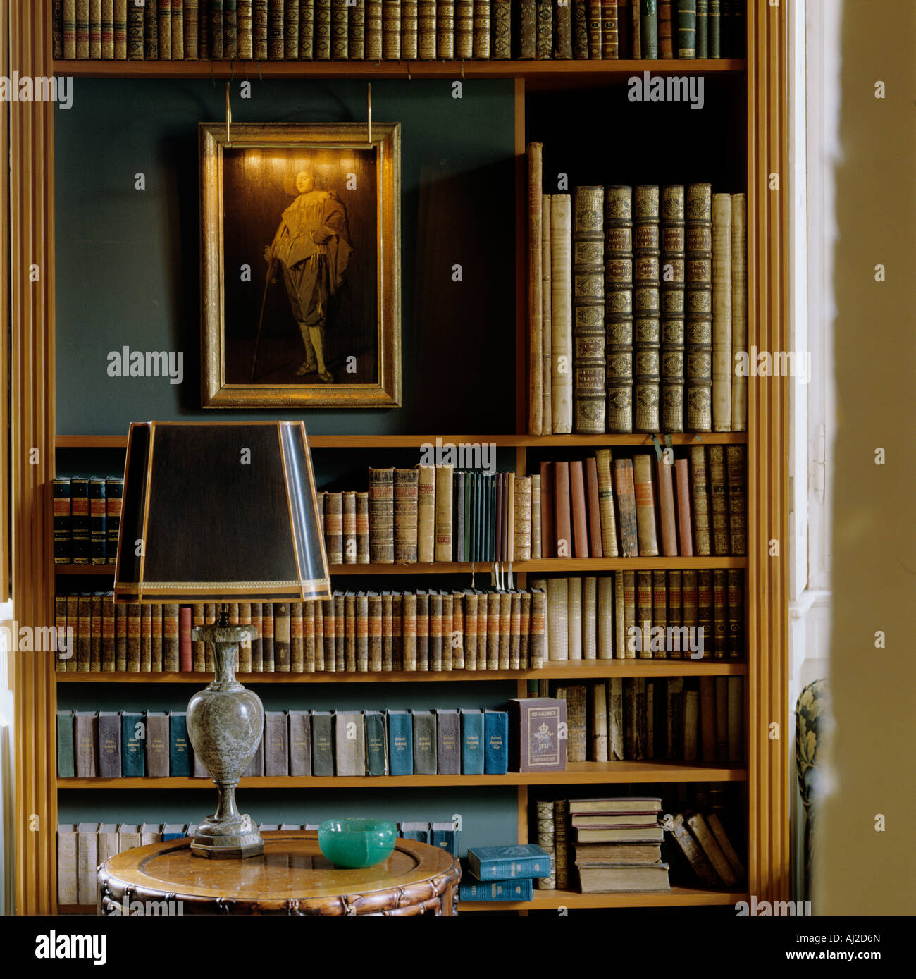 Old Book Display Case ~ Decorative display of antique books and an oil painting in