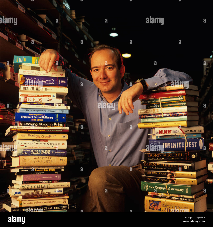 usa washington amazon com president jeff bezos with stacks of books inside huge warehouse in seattle