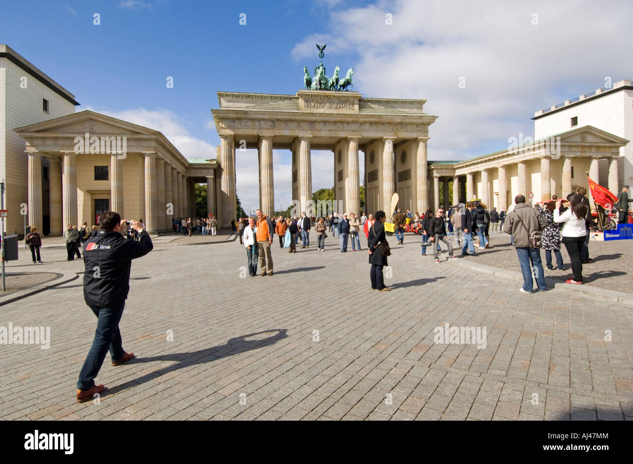 A wide angle view of tourists taking photographs at the Brandenburger Tor  or Brandenburg Gate on