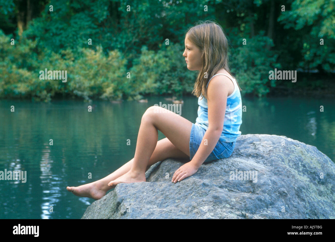 Girl sitting on rock thought you