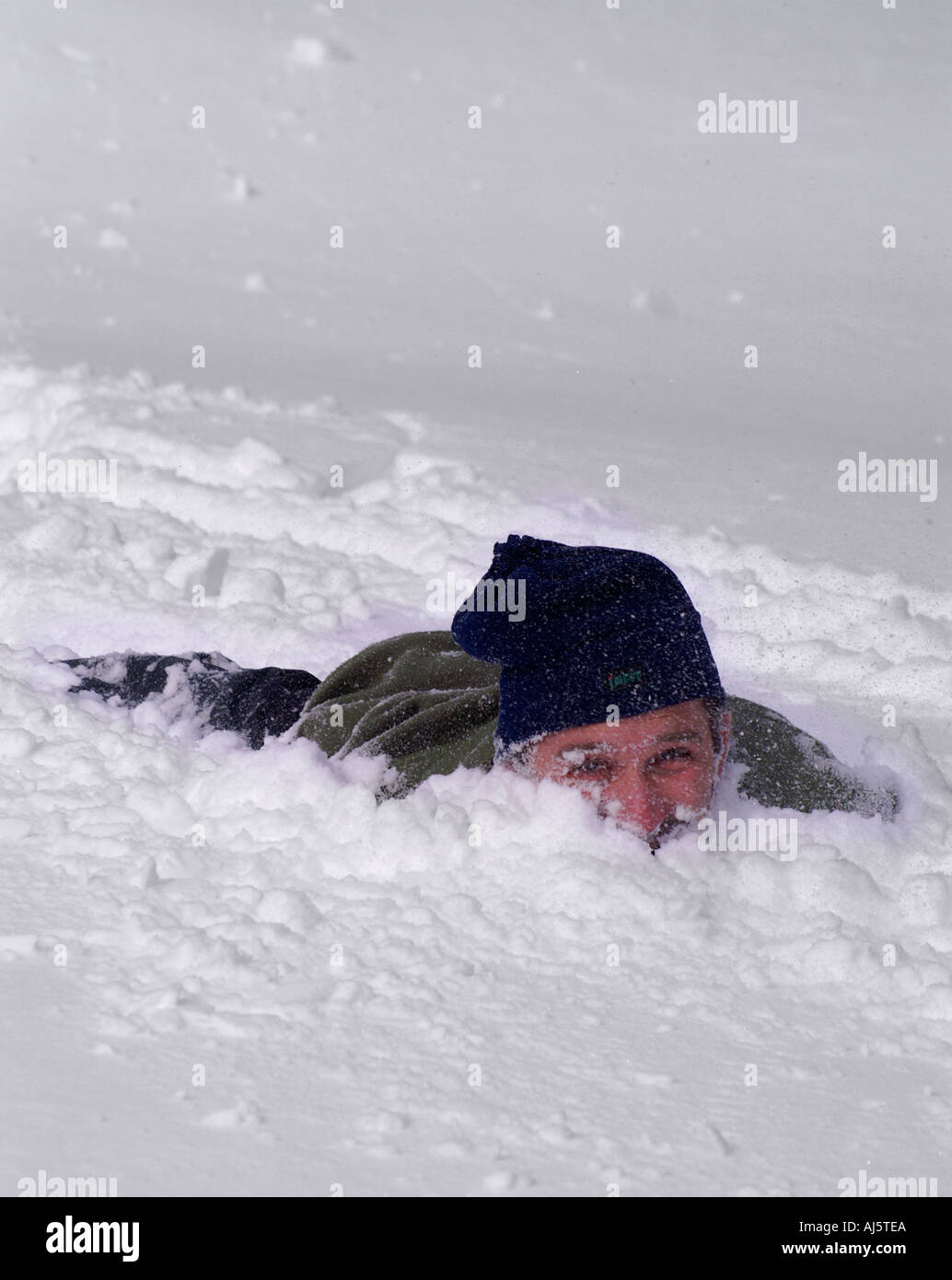 Man Buried In Snow Stock Photo, Royalty Free Image