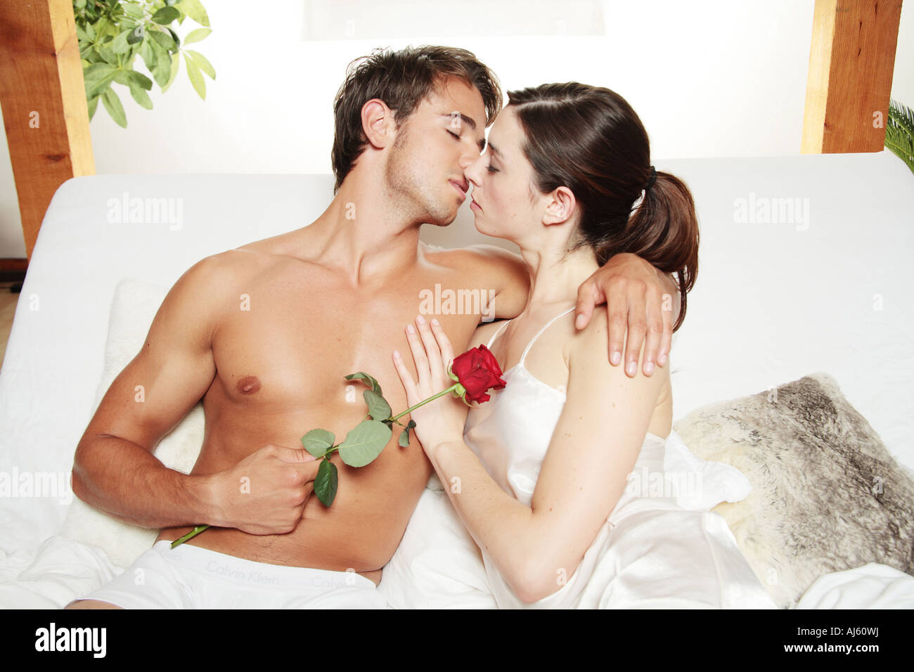 romantic couple lying on a bed kissing   Stock Image. Happy Couple Dreaming In Bed Stock Photos   Happy Couple Dreaming