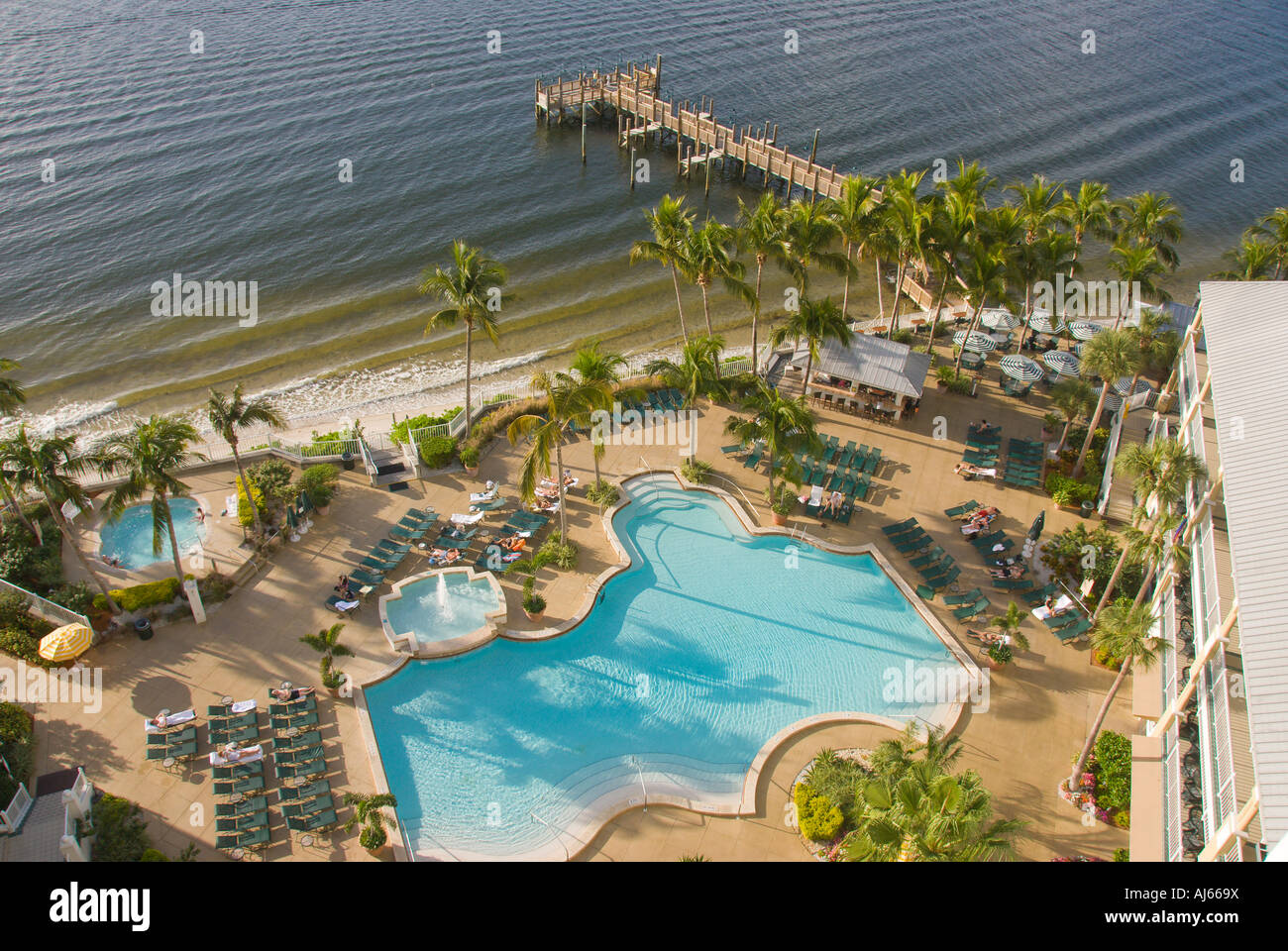 Swimming pool next to beach and fishing dock aerial for Fishing resorts in florida