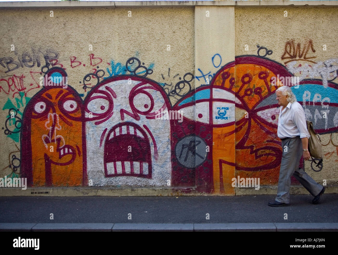 Graffiti wall zagreb - A Man Is Passing By Graffiti Wall In Downtown Of Zagreb Croatia