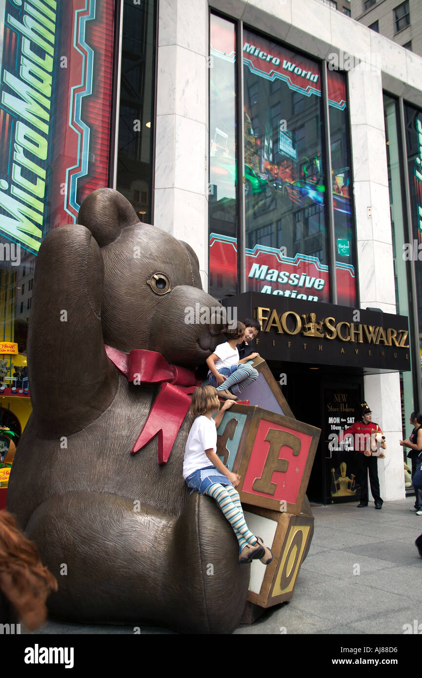Children play on giant teddy bear outside fao schwarz toy store on children play on giant teddy bear outside fao schwarz toy store on fifth avenue midtown manhattan new york ny sciox Image collections